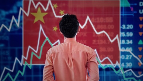 Man looking at a chart of economic or price trends with a Chinese flag in the background.