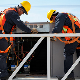 Facilities Management Employees in Mexico Servicing AC UNit