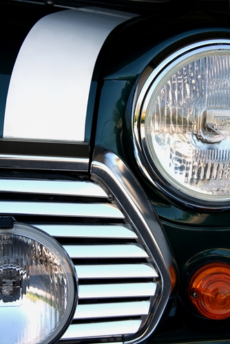A view at a headlight of a car that was manufactured in Mexico.