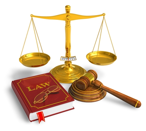 There is a scale along with a gavel and a law book.