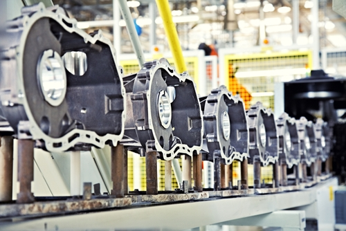 An assembly line within an automotive manufacturing factory that is assembling the same type of car part.